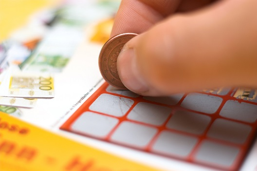 Woman playing scratchcards